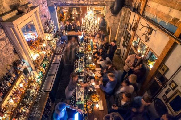 Whislers Interior looking down on bar with patrons