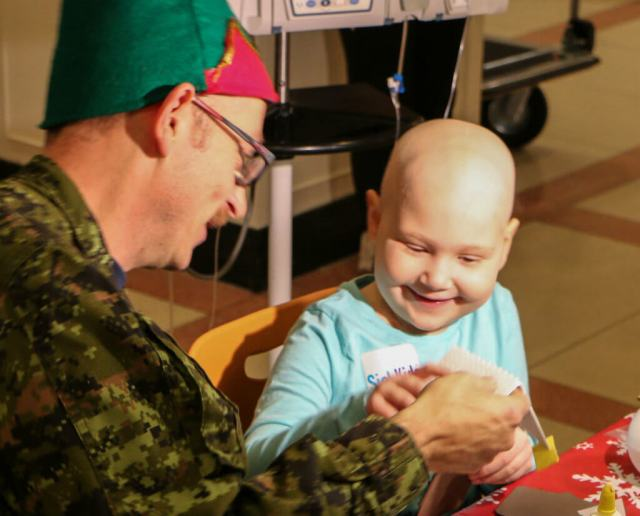 Hospital patients make Christmas crafts with Santa's elves during Operation Ho Ho Ho. Steve Bigg Photos