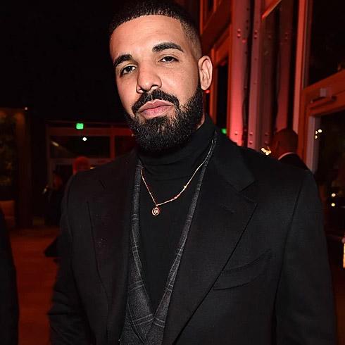 Drake in a fancy black suit