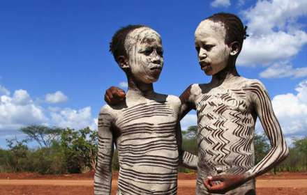 Young Hamar boys painted with white ash. The Gibe III dam also places their tribe at risk
