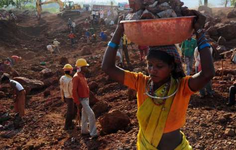 A Baiga woman works for daily wages on Vedanta's Bodai-Daldali bauxite mine, Chhattisgarh
