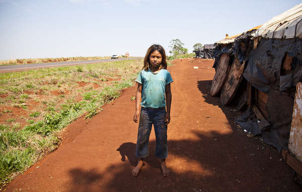 Many Guarani are forced to live in overcrowded reserves or in makeshift camps on the roadside following the theft of their land.