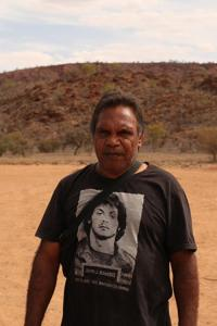 Tim MacNamara, artist and community worker from Hidden Valley, one of 16 town camps around the margins of Alice Springs. Seven town camps have no internet at all. In Hidden Valley, up to 400 residents share one satellite WiFi hotspot. Photo: Else Kennedy