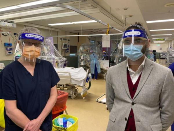 Dr Monty (pictured right) with Dr Craig French, director of the ICU at Western Health, where the hoods are being used in a clinical trial. Photo: supplied.