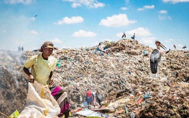 Women searching for plastics to recycle at Dandora dumpsite, Nairobi, Kenya