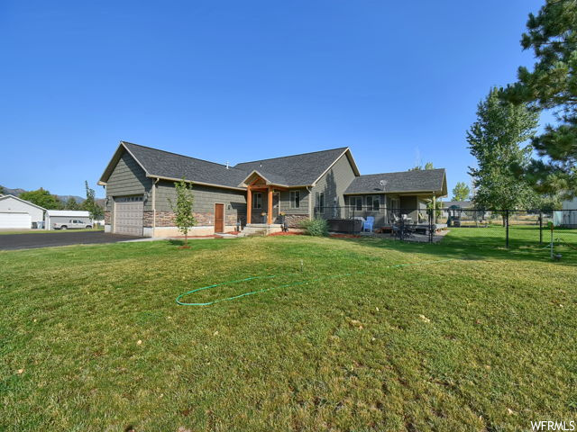 Stunning Cache County Horse property!! The home was built in 2015 and sits on 1.41 acres with breath taking views of the surrounding mountains. The home has lots of open entertaining space with a beautiful master suite, plenty of storage throughout the home. Kitchen and family room is large and inviting, with rock fireplace and hardwood floors. Double car garage and an additional  building that can be used as a mother in law apartment, a workshop or another garage.