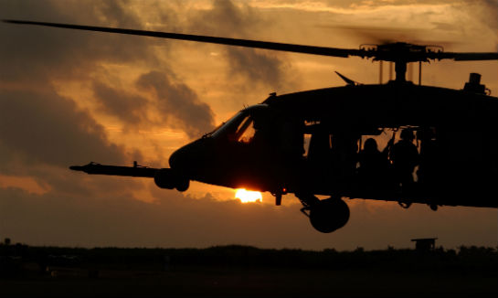 An HH-60G Pave Hawk prepares to land after training in Lungi, Sierra Leone. U.S. Air Force Photo