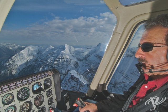 Minuteman founder Jerry Mamuzich, seen here flying a tour over Montana's Glacier National Park in early spring, began working in aviation at the age of 12, performing ground-support functions for his father's fixed-wing operation. Robin Elledge Photo