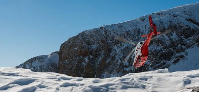 An EC120B takes off from a mountain landing spot in the Swiss Alps.
