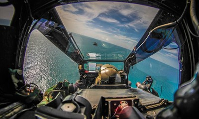 The view from an Apache cockpit while conducting deck landing qualifications.