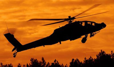 Royal Netherlands Air Force AH-64 Apache entering the low flying area for some evening flying against a beautiful sky.