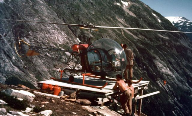 A Bell 47D-1, CF-GGC, high in British Columbia's coastal mountains during the Kemano project in 1953. Purchased by the Aluminum Company of Canada in 1952, the helicopters were crewed and maintained by Okanagan Helicopters. Alcan Photo