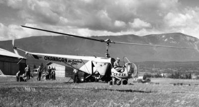 Okanagan Air Services first Bell 47B-3, CF-FZX, piloted by Carl Agar, lifts off to spray insect-infected forests in the Windermere Valley in the East Kootenays. This operation, among others in 1948, helped prove the value of helicopters. B.C. Ministry of Forests Photo