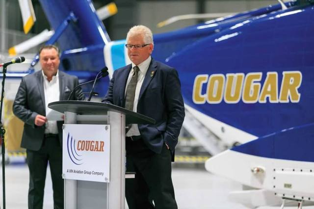 Ken Norie (right), president and CEO of Cougar Helicopters' parent company VIH Aviation Group, was part of the presentation team at the facility's grand opening in November. Cougar COO Hank Williams (left) watches on. Heath Moffatt Photo