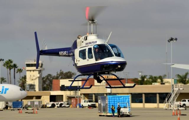 A Pasadena Police Department Bell OH-58A+ comes into land. More than 20 law enforcement agencies were represented at the fly-in. Skip Robinson Photo