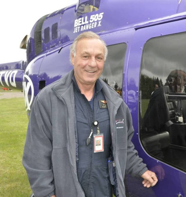 This year's celebratory helicopter pilot at the HeliClub fly-in was retired National Hockey League right-winger Guy Lafleur, wearing a Bell Helicopter pilot's identification badge.