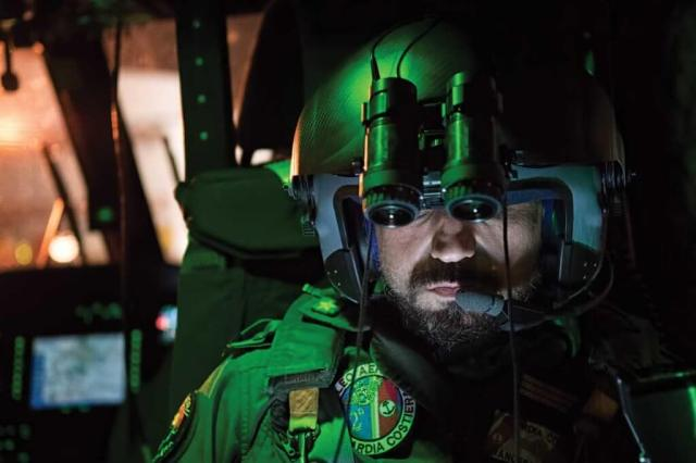 A rescue swimmer on a night mission. Guardia Costiera crews know that the most important call of their careers could come at any moment -- including at night or in bad weather.