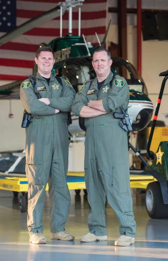 TFO Ed Stagmiller (left) and pilot Sean Marston prior to beginning their evening shift.