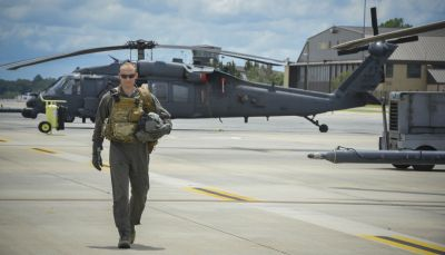 Commandant Micka, a French exchange pilot and assistant director of operations for Moody's 41st Rescue Squadron, walks on the flightline past an HH-60G Pavehawk on Aug. 2, 2017, at Moody Air Force Base, Georgia. Prior to his arrival at the 41st RQS, Micka transitioned from flying the French Air Force's EC725 Caracal helicopter to learn the HH-60. Since his childhood, Micka aspired to serve and fly for the French and U.S. military as a rescue pilot. U.S. Air Force Photo