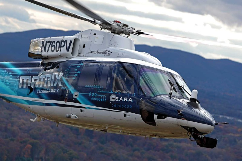 """Sikorsky has been developing its Matrix Technology autonomy kit in SARA, an S-76 retrofitted with fly-by-wire flight controls. According to Sikorsky director of autonomous programs Igor Cherepinsky, the larger platform has been helpful in accommodating the supercomputer in the back of the aircraft: """"We're not limited by payload or power, we can experiment all we want."""" Ted Carlson Photo"""
