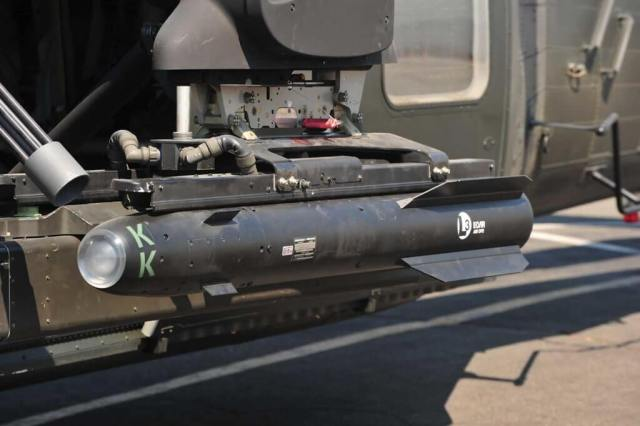 Rockets and gun pods are attached to the aircraft's left ESSS.