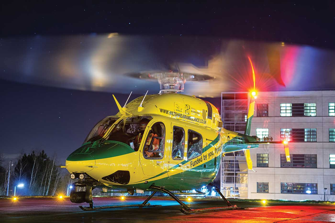 Helicopter rests on helipad