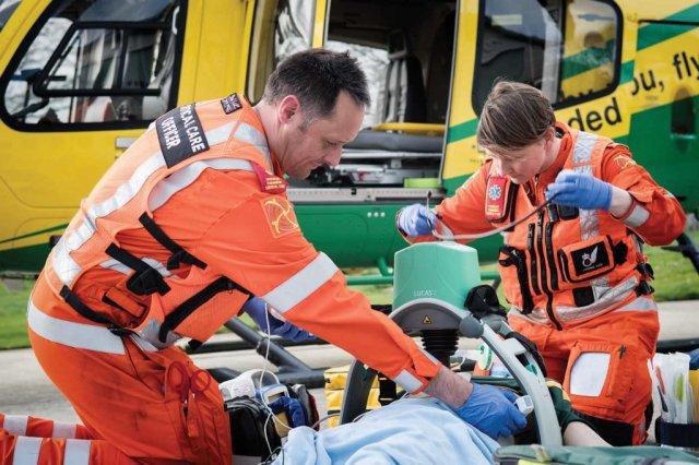 Critical care paramedics demonstrating the Lucas cardiopulmonary resuscitation (CPR) device.
