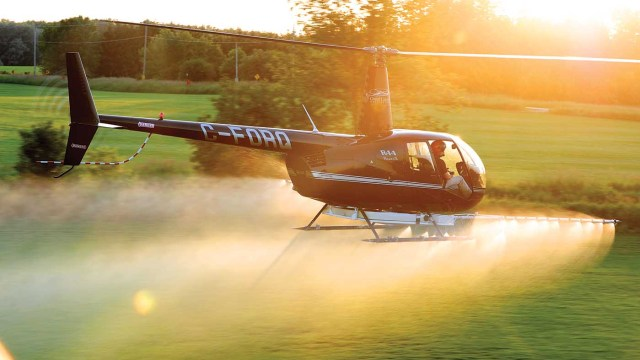 A Robinson R44 Raven II belonging to Great Lakes Helicopter of Kitchener, Ontario, completes spray work in the area. Mike Reyno Photo