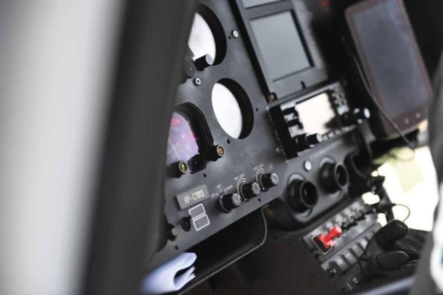 Closeup of flight instruments in cockpit.