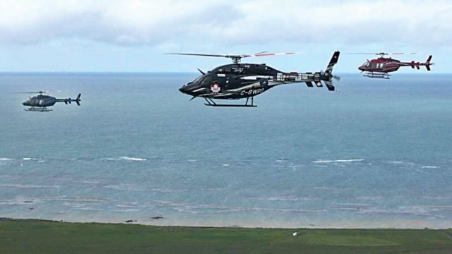 Bob Dengler's Bell 429 (centre) flies in formation over Iceland.