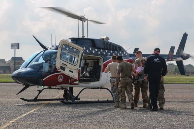 Soldiers assigned to the 1-143 Infantry Regiment, Airborne Battalion, help transfer a patient to a helicopter at a medical treatment facility in Port Arthur. Spc. Austin Boucher Photo