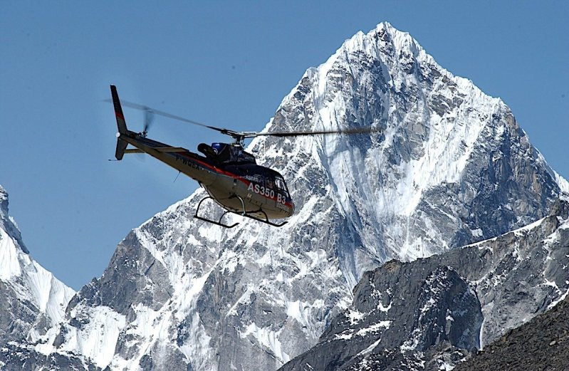 Airbus helicopter in flight near Mount Everest