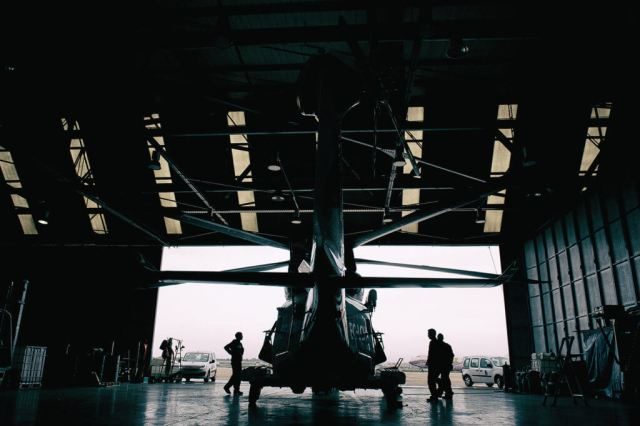 Crewmembers prepare to drag the AW139 out from the hangar for an afternoon training sortie with a civilian vessel off the coast of Valencia. Lloyd Horgan, Vortex Aeromedia Photo