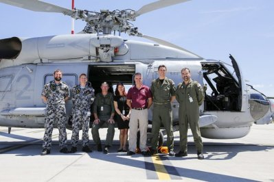 Leading Seaman Daniel Crowe ; Chief Petty Officer Michael Bryan; WO Brian Pashley ; Stephanie Boyle; Ian Parrott ; Lt Caleb Muggeridge; and LCdr Damien Liberale with the Australian Navy's S-70B-2 Seahawk helicopter fondly known as 'Christine.' Dallas McMaugh Photo