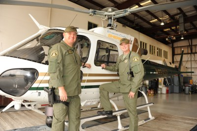 Jerry Osterloh (left) and Eric Bashta stand in front of a Riverside County Sheriff's Department AS-350 B3 (H125). HAI Photo