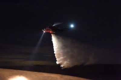 A Coulson Aviation Sikorsky S-61, equipped with a 4,000-liter belly tank and night vision imaging systems, takes part in nighttime firebombing trials in Victoria, Australia. Coulson Aviation Photo