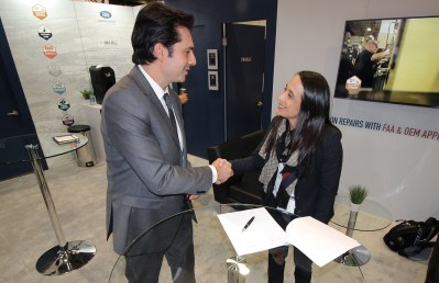 Able general manager Gabriel Massey shakes hands with AVESA president Sophia Valdez at the signing ceremony at Heli-Expo 2018.