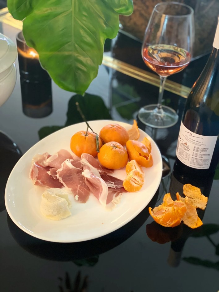 Charcuterie wine and clementines.