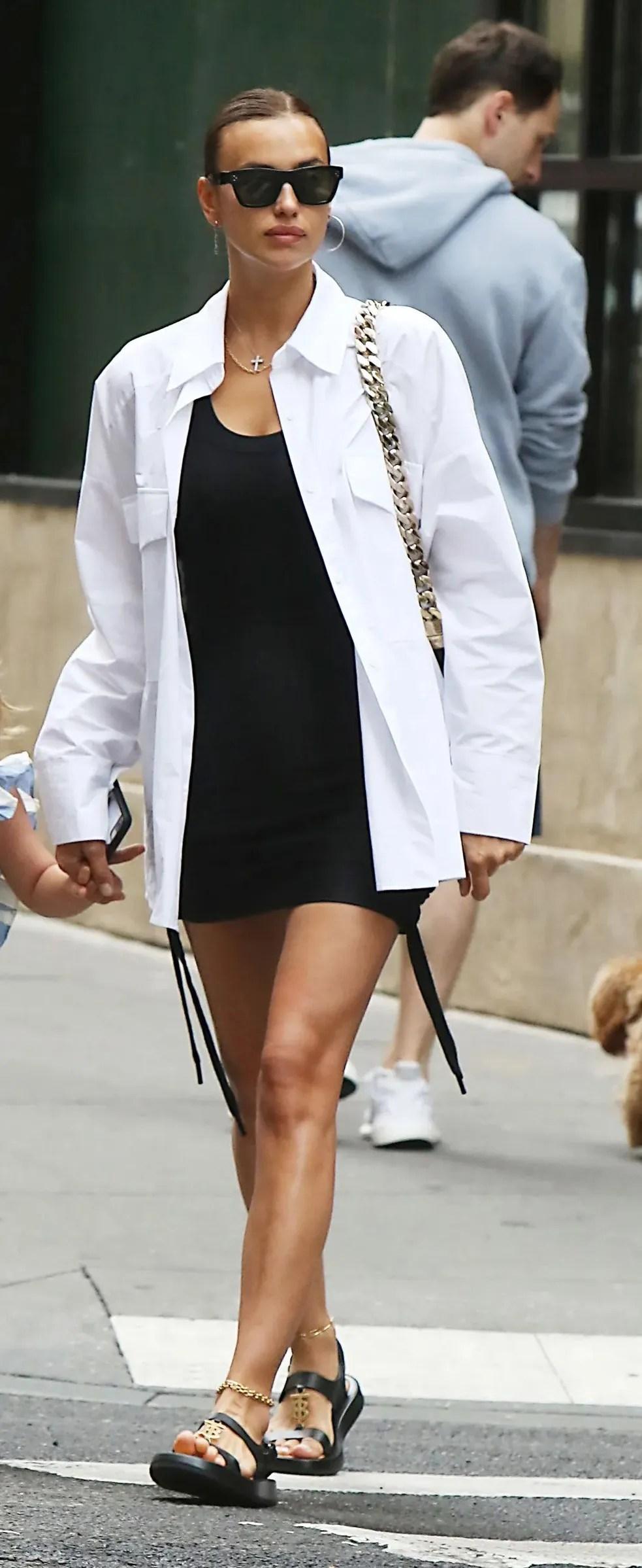 Irina Shayk wearing bodycon LBD with white button up