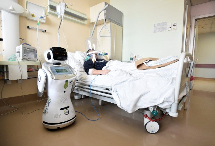 A robot helping medical teams treat patients suffering from the coronavirus disease (COVID-19) is pictured at a patient's room, in the Circolo hospital, in Varese, Italy April 1, 2020. REUTERS/Flavio Lo Scalzo - RC2OVF92BNGT