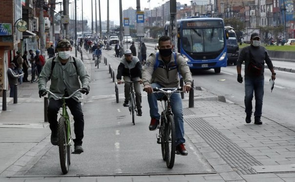 Cyclists use city centre bike lanes in Bogota, Colombia.