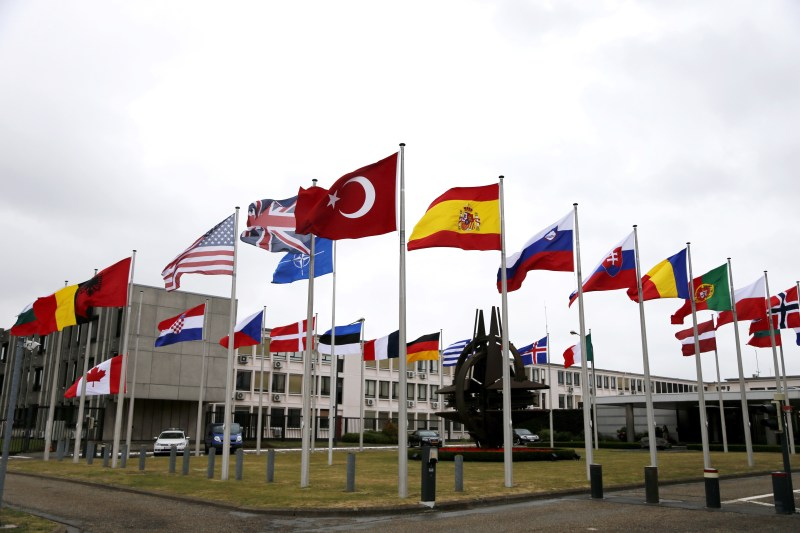 Flags flying outside a NATO meeting