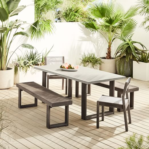 concrete outdoor dining table portside benches portside textilene chairs set