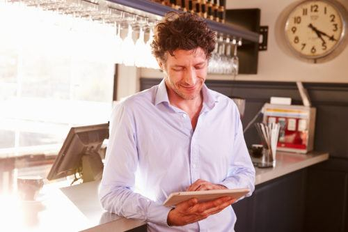 restaurant owner using an iPad