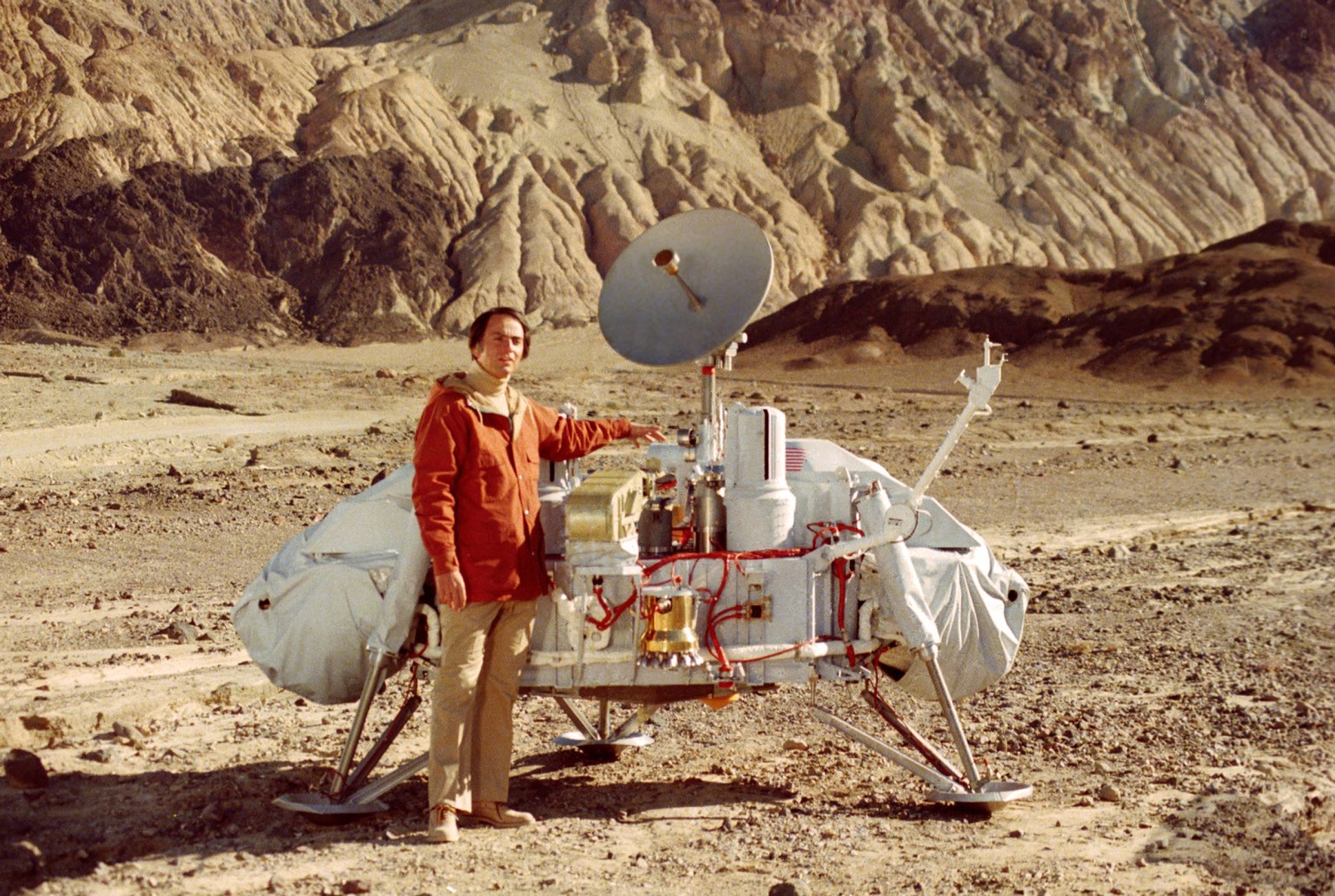 NASA photo of Dr. Carl Sagan with a model of the Mars Viking Lander, in Death Valley, California. Or was it taken on Mars? How could we tell, if we lacked sharpened and practiced critical thinking practices?