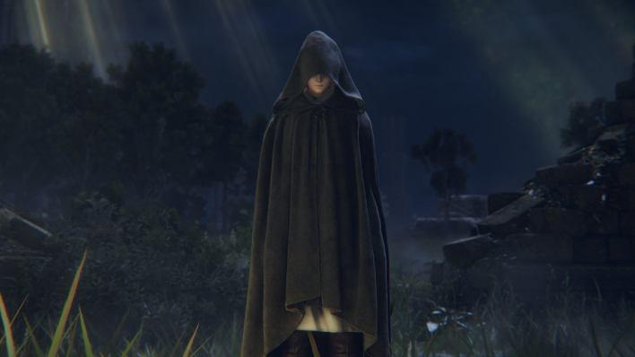 A mysterious cloaked figure in an Elden Ring screenshot.
