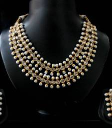 Buy ANTIQUE GOLDEN STONE NECKLACE SET Necklace online