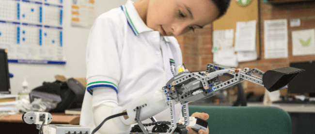 a child using a lego prosthetic hand