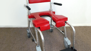 photo of a red Go! shower and commode chair