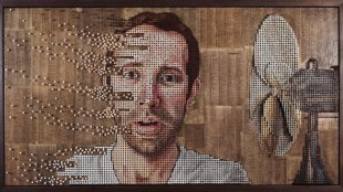 """Fading Thoughts"" by Andrew Myers - a table fan is shown blowing parts of a man's face off."